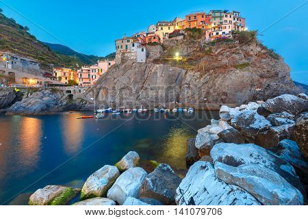 Night view of Manarola fishing village, seascape in Five lands, Cinque Terre National Park, Liguria, Italy.
