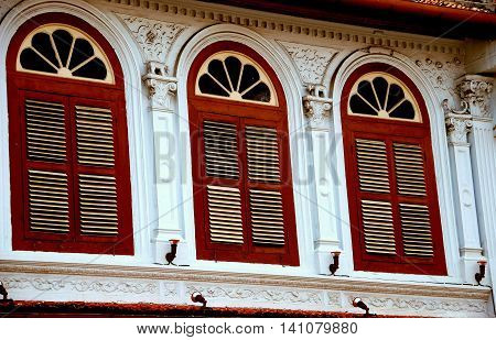 Melaka Malaysia - December 28 2007: Finely restored Chinese shop house with three fan windows and wooden louvered shutters on Jonker Walk