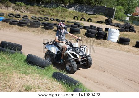 Man Or Young Boy Is Driving A Quad