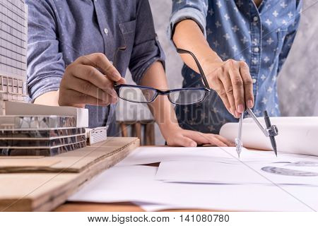 business architect drawing on architectural project teamwork Concept