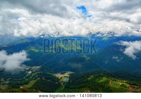 Beautiful mountain views with large clouds and mountain lake bottom