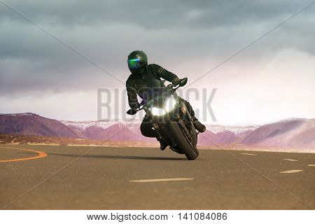 young man riding big motorcycle on asphalt highway use for people leisure traveling and adventure lifestyle