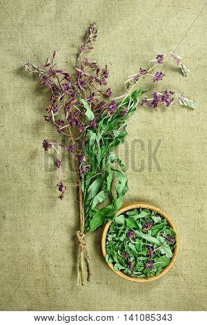 Fireweed.Dried herbs for use in alternative medicine.Herbal medicine phytotherapy medicinal herbs.For preparation of infusions decoctions tinctures powders ointments tea.Background green cloth