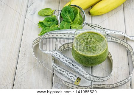 the Ingredients spinach, buttermilk, kiwi and banana for a tasty smoothie on a light background.