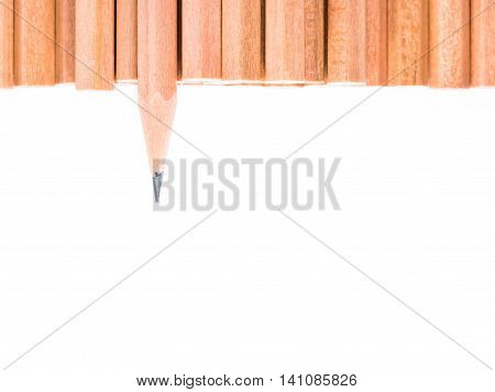 Sharp brown pencil stand out of other brown pencils - business concept of leader and success - isolated object on white background