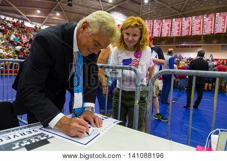 Mechanicsburg PA - August 1 2016: A Trump supporter asks John Roberts Fox News Correspondent for an autograph on a campaign sign at the Donald Trump political rally.