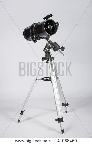the reflector telescope on a white background