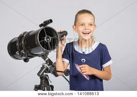 The Young Astronomer Happily Standing On The Starry Sky