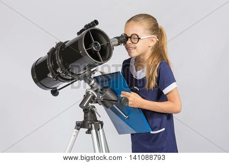 The Young Astronomer Happy To Look Through The Telescope Recording Observations