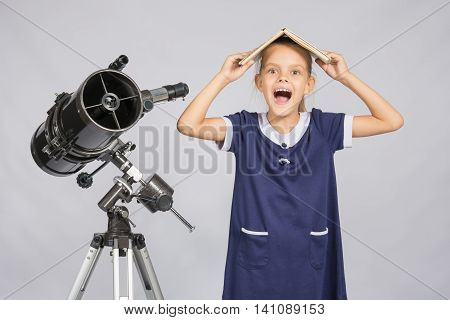Schoolgirl Covered Her Head With A Textbook And Cry Looking At The Frame, Standing At The Telescope