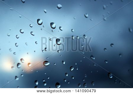 Rain pouring down outside the window drops of water