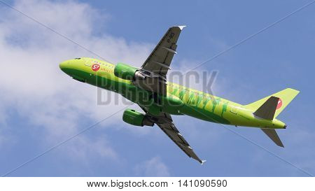 Moscow region - 31 July 2016: Green passenger aircraft Airbus A320-21 S7 Airlines flies to Moscow's Domodedovo airport July 31 2016 Moscow Region Russia