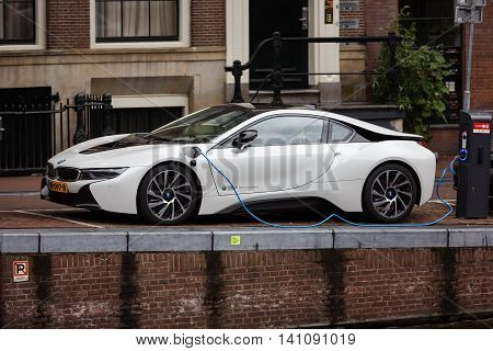 Amsterdam Netherlands - July 01 2016: BMW i8 car being charged on a street of Amsterdam