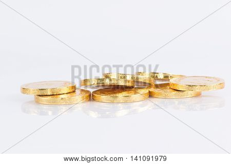 The chocolate gold coin  isolated on white background, clipping path