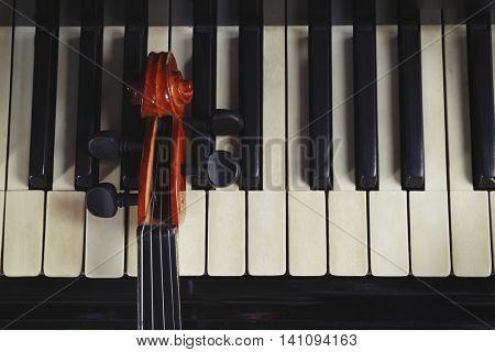Violin neck on piano keys