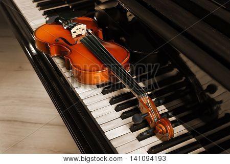 Violin on piano keys, closeup