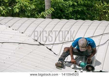 Workers are saw a new white roof