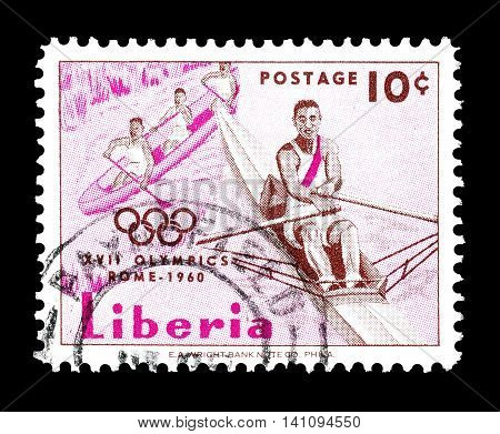 LIBERIA - CIRCA 1960: Cancelled postage stamp printed by Liberia, that shows Rower and canoeists.