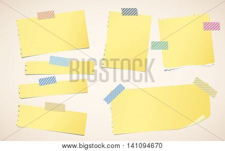 Pieces of ripped yellow blank notebook paper are stuck with striped sticky tape.