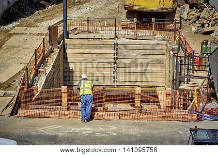 Construction Worker Laying Wire For Concrete Foundation