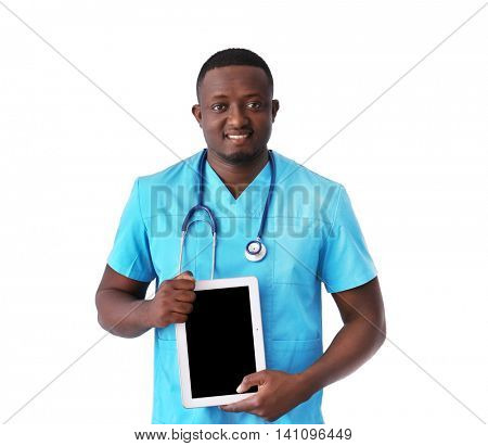 Professional African doctor with tablet on light background