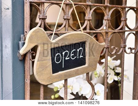 Open sign of a store. Duch signboard.