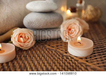 Beautiful spa composition with flowers on wicker mat