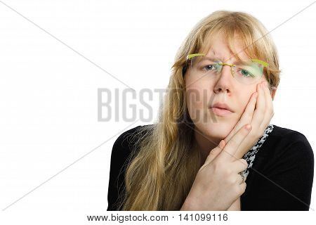 Long haired blonde young chubby girl has a toothache