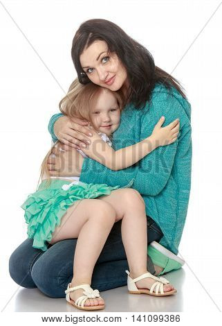 Happy little girl clung to my beloved mother - Isolated on white background