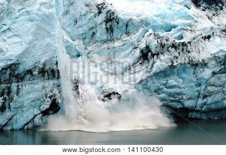 A lot of ice breaking off of a glacier, calving, in glacier bay Alaska