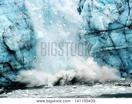 A glacier breaking apart, calving, in glacier bay Alaska