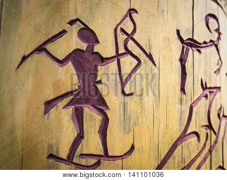 Shor Ancient petroglyphs on wooden pillars. background