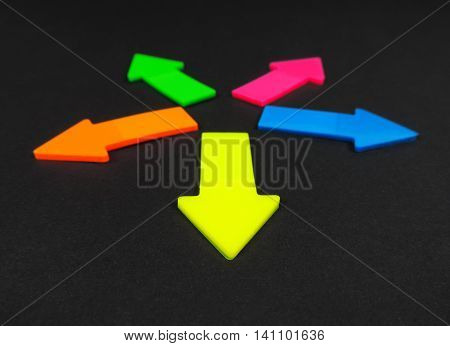 Neon colored arrows, isolated on black background