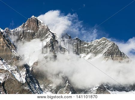 top of Lhotse and Nuptse with clouds on the top - way to mount Everest base camp Khumbu valley Sagarmatha national park Nepalese Himalayas
