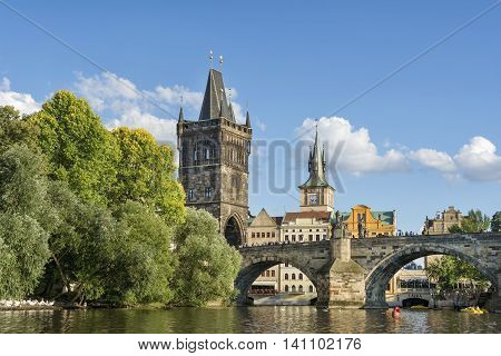 PRAGUE, CZECH REPUBLIC, JULY 5,2016: Charles Bridge and Old Town Bridge Tower, famous landmarks with gothic architecture attracting thousands of tourists everyday.