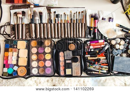 makeup cosmetics and brushes on the white table