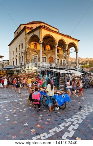 ATHENS, GREECE - AUGUST 02, 2016: Sweets sellers and tourists in front of the old mosque in Monastiraki square on August 02, 2016.