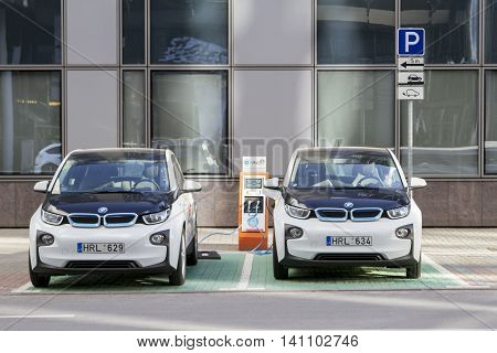 Vilnius, Lithuania - August 2, 2016: Electric car charging station with cars in the city center.