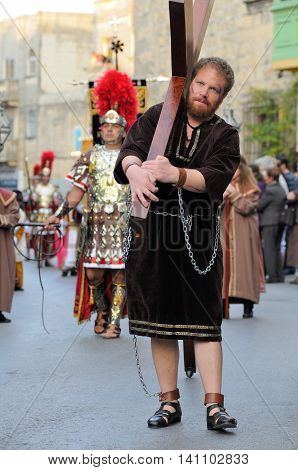 MOSTA, MALTA - APR 22 - Biblical enactment of the passion (actor carries cross) during in the Good Friday procession in the village of Mosta in Malta April 22, 2011