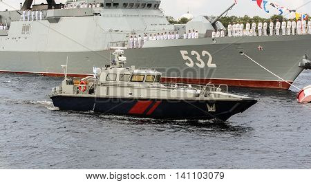St. Petersburg, Russia - 31 July, Boat protection from a warship, 31 July, 2016. Festive parade of warships on the Neva River in St. Petersburg.