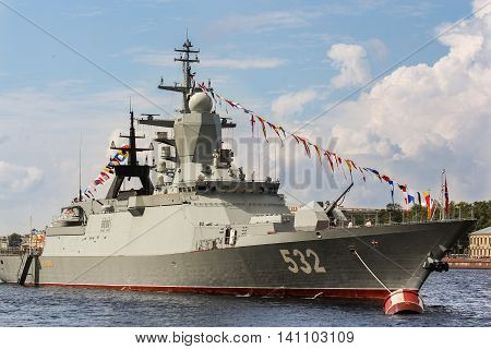 St. Petersburg, Russia - 31 July, Warship with signal flags, 31 July, 2016. Festive parade of warships on the Neva River in St. Petersburg.