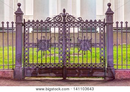 Night view of wrought iron ornamental gates of the Trinity Cathedral in St. Petersburg Russia