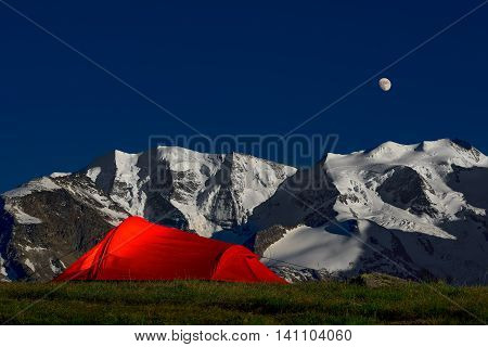 Tent In The Solitude Beneath The Glaciers Of The Alps