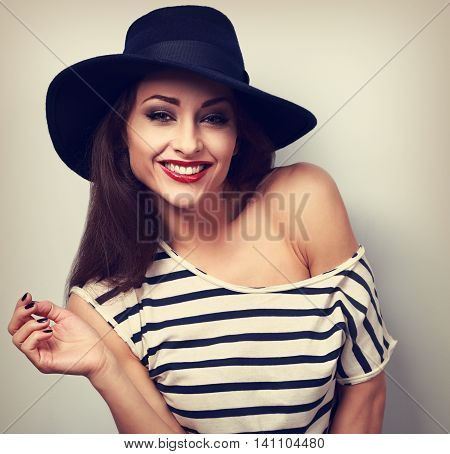Happy Toothy Laughing Makeup Female Model In Black Elegant Hat With Red Brigh Lipstick. Toned Vintag