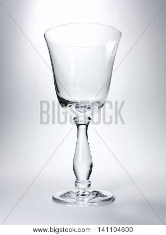 Empty wine glass, studio shot with copy space.
