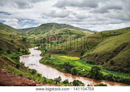 Red water of the river of Tsiribihina with mountains on the background, Madagascar