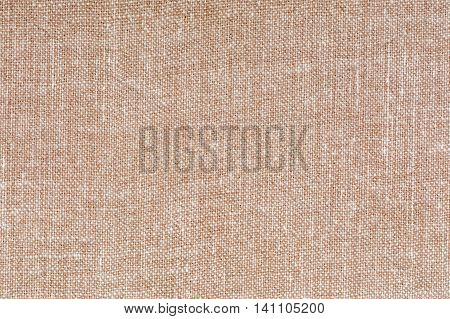 Beige and white decorative canvas fabric texture background, close up