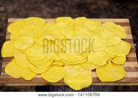 Yellow cake lie on a wooden tray. Tasty