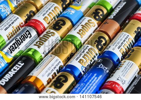 Moscow, Russia - January 05, 2016: Used alkaline batteries AA size format of different brands ready for recycling lying in a rows. Studio shot.