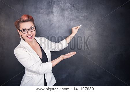 Beautiful Happy Teacher With Piece Of Chalk